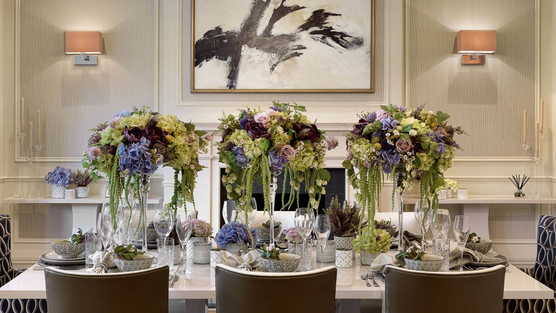 Dining room as decorated by Moska Design and Style with flowers and ceramic crockery