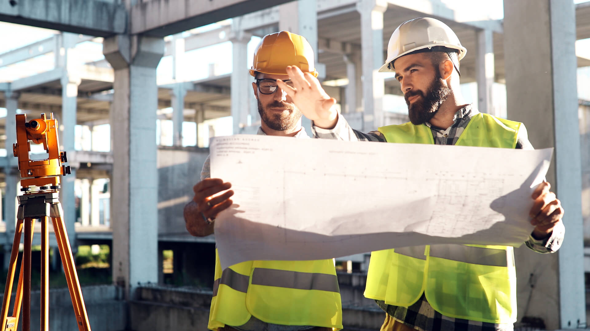 Two men discussing plans at a construction site
