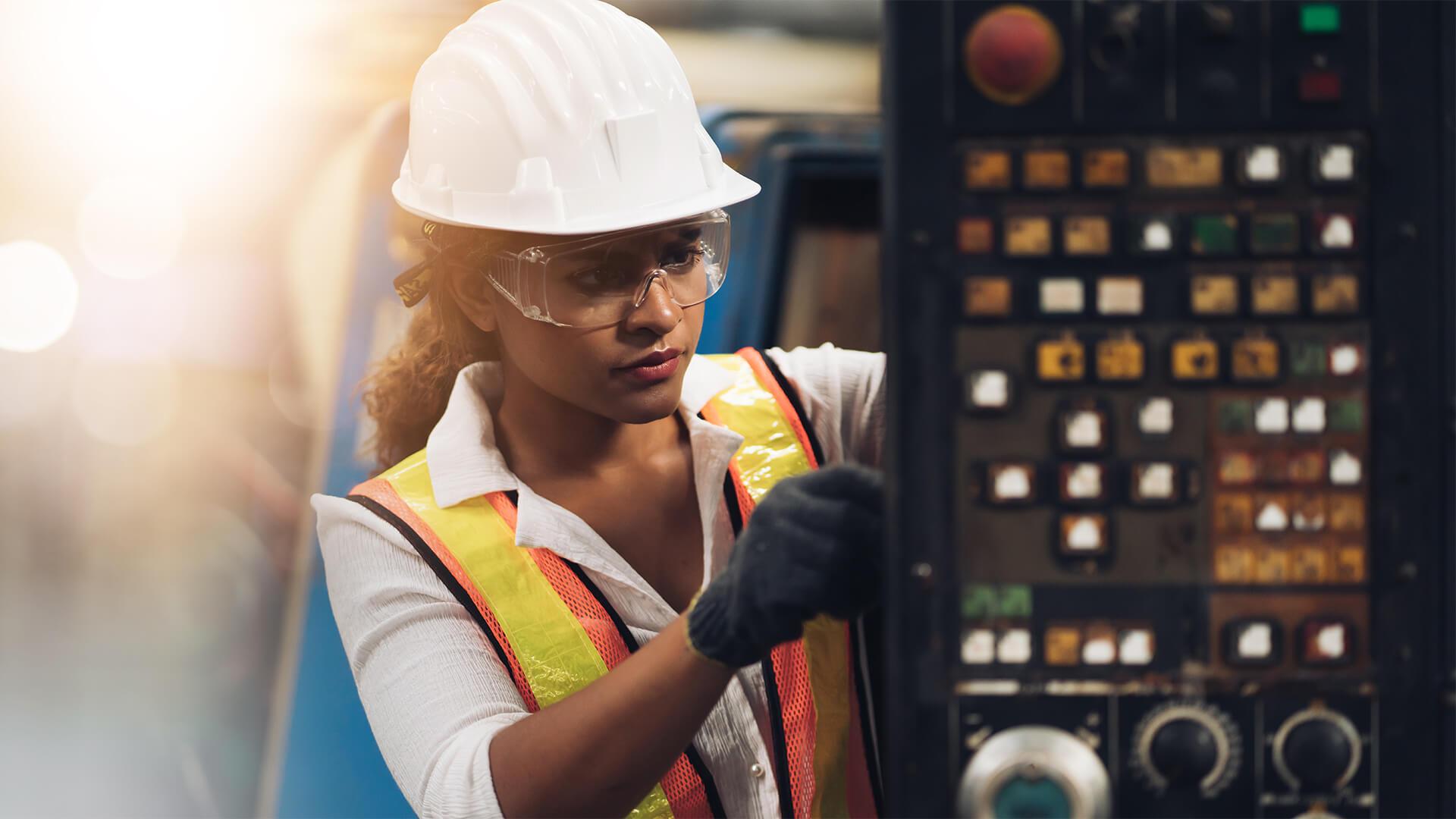 Engineer inspecting construction equipment