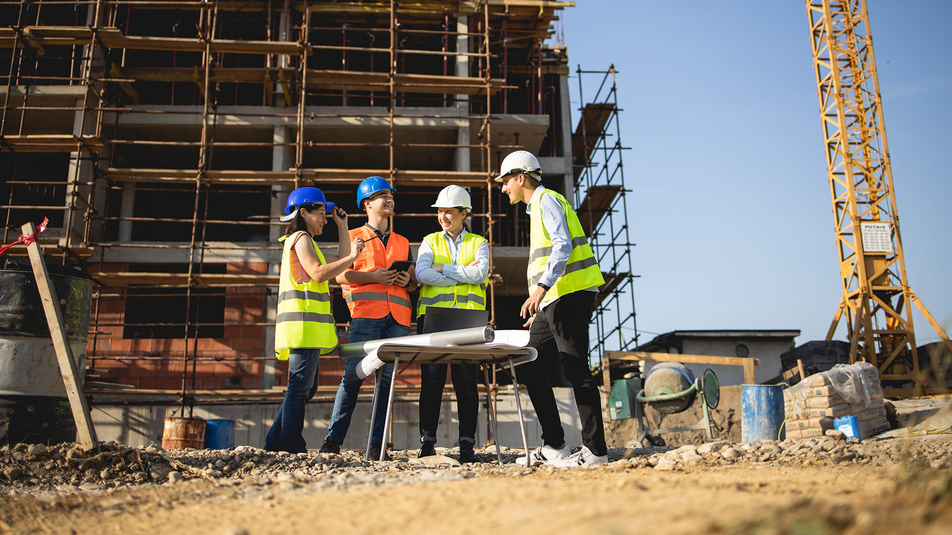 Four construction managers having a meeting on site