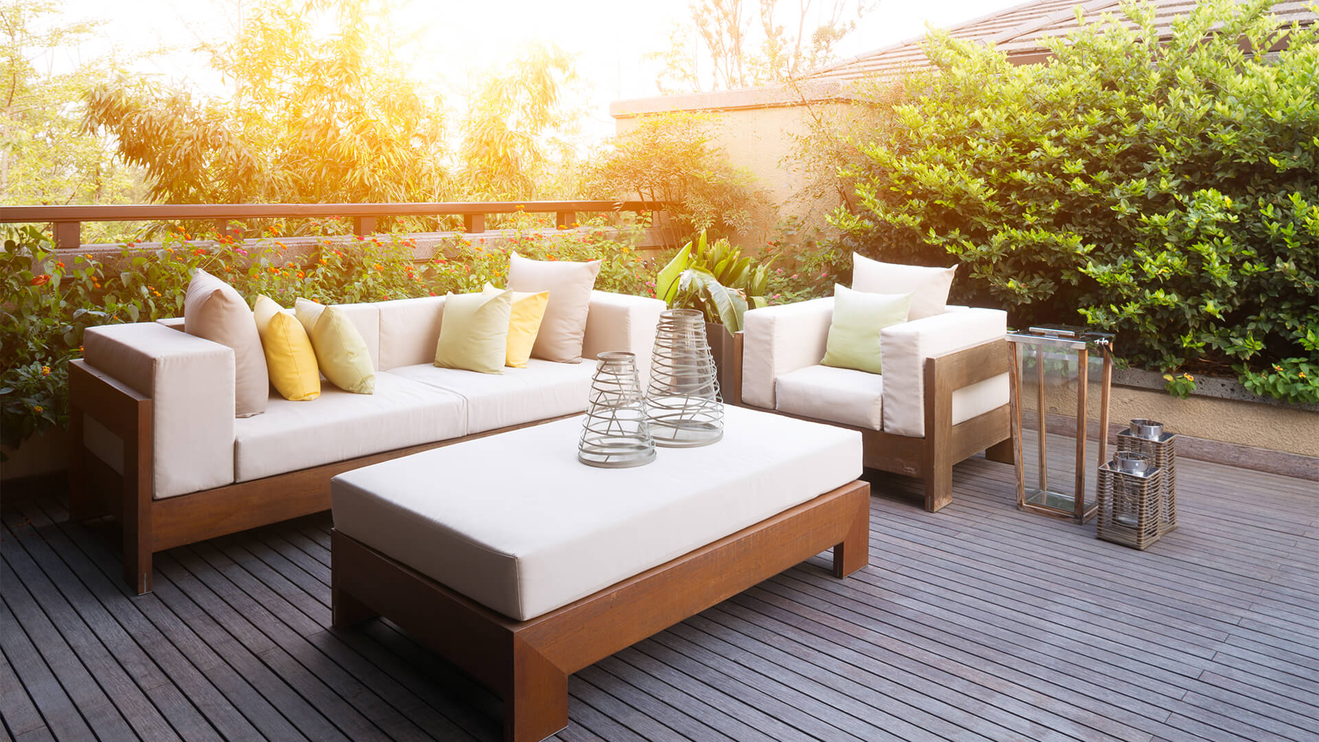 Outdoor living space with sofas and coffee table and lanterns