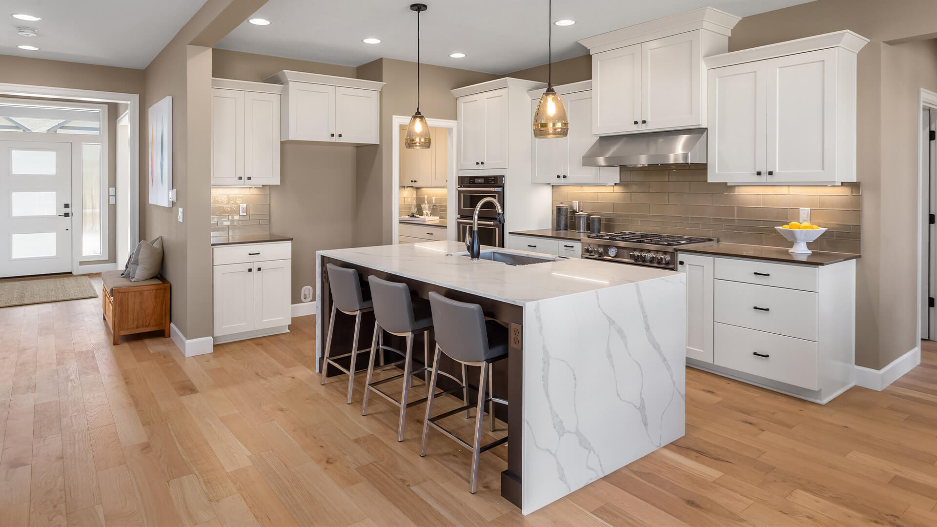 Modern kitchen with wooden floors and marble counters