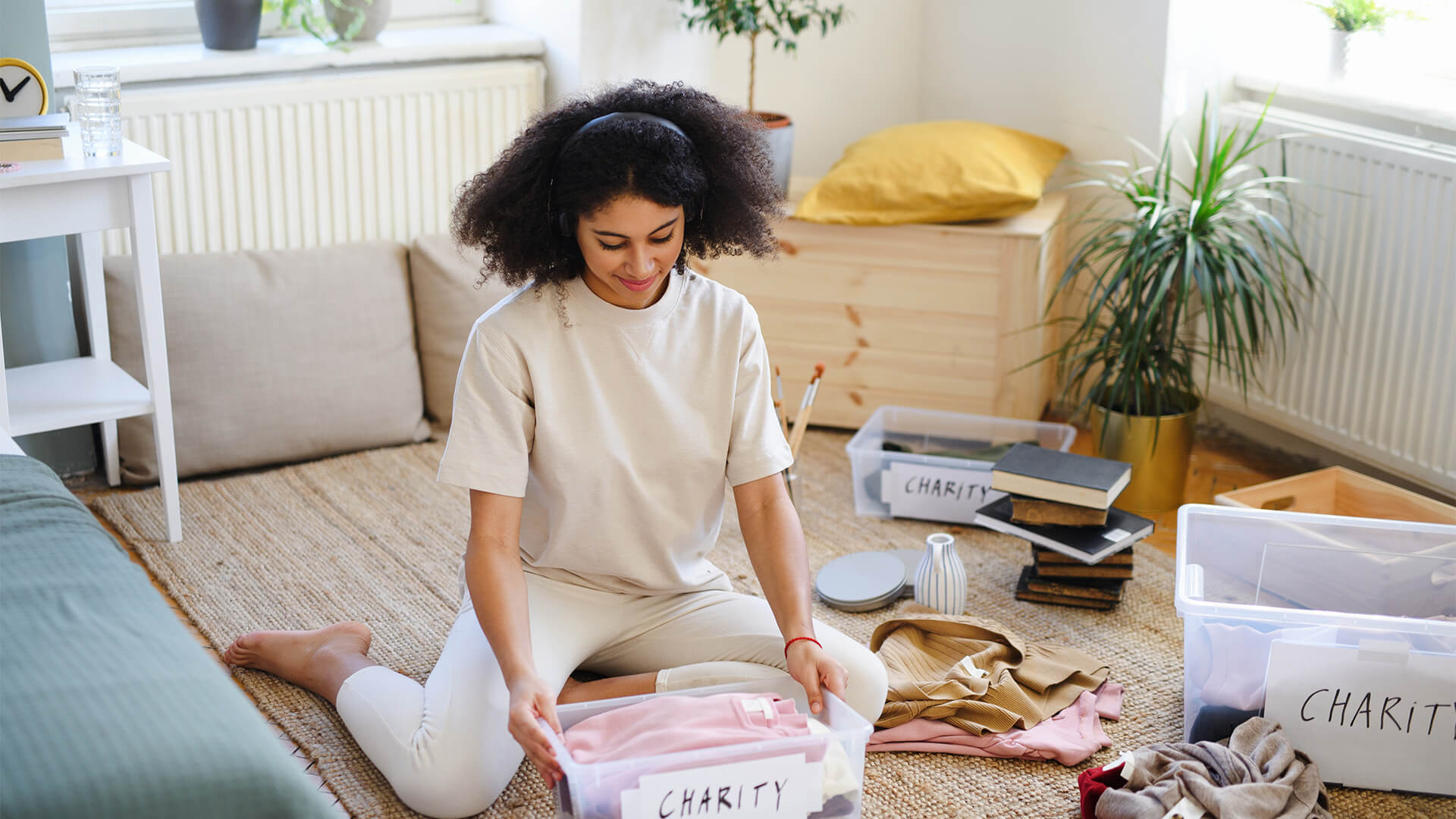Woman sorting her items into boxes labled