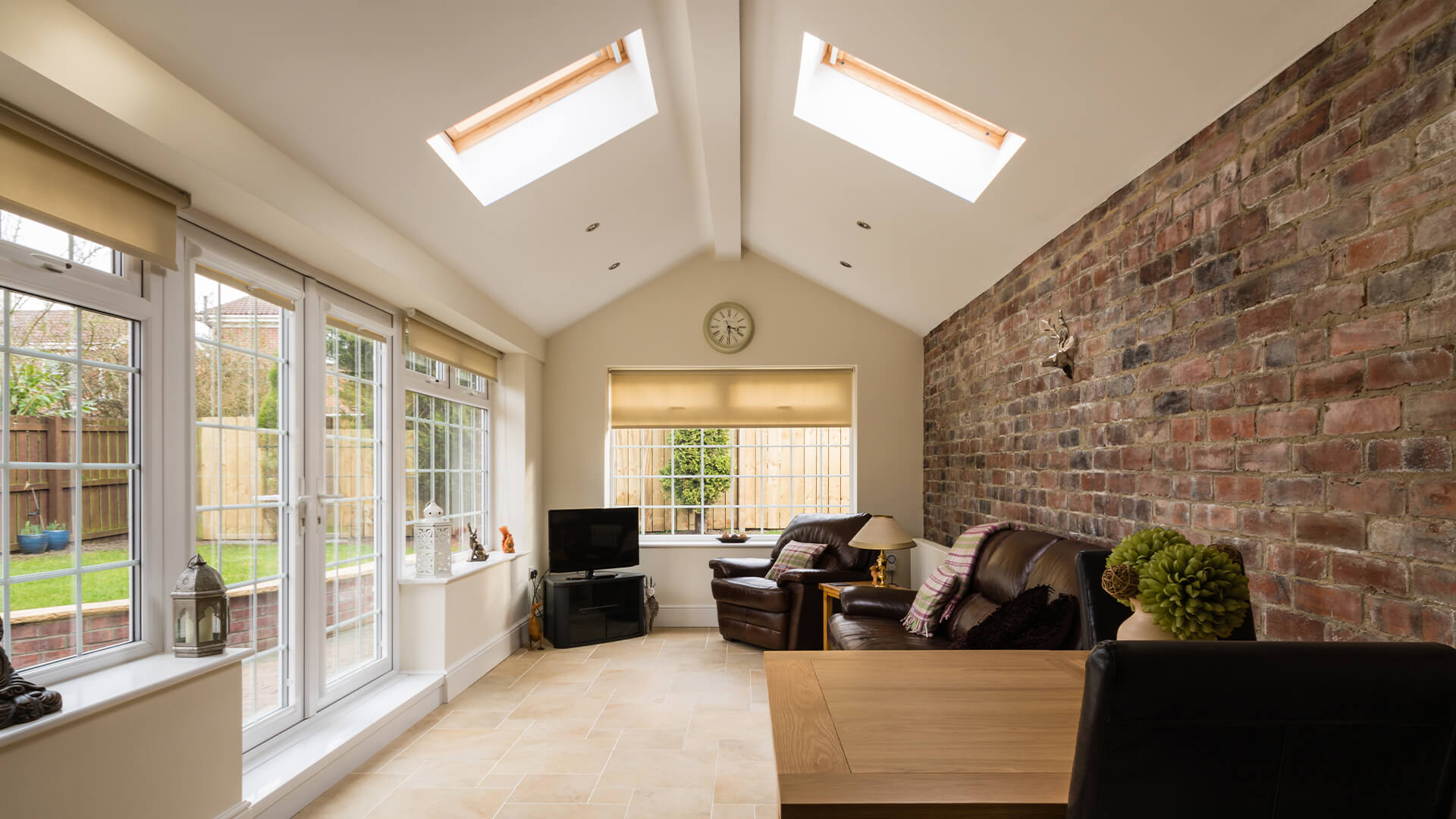 Extension room in a home, with exposed brick and large windows