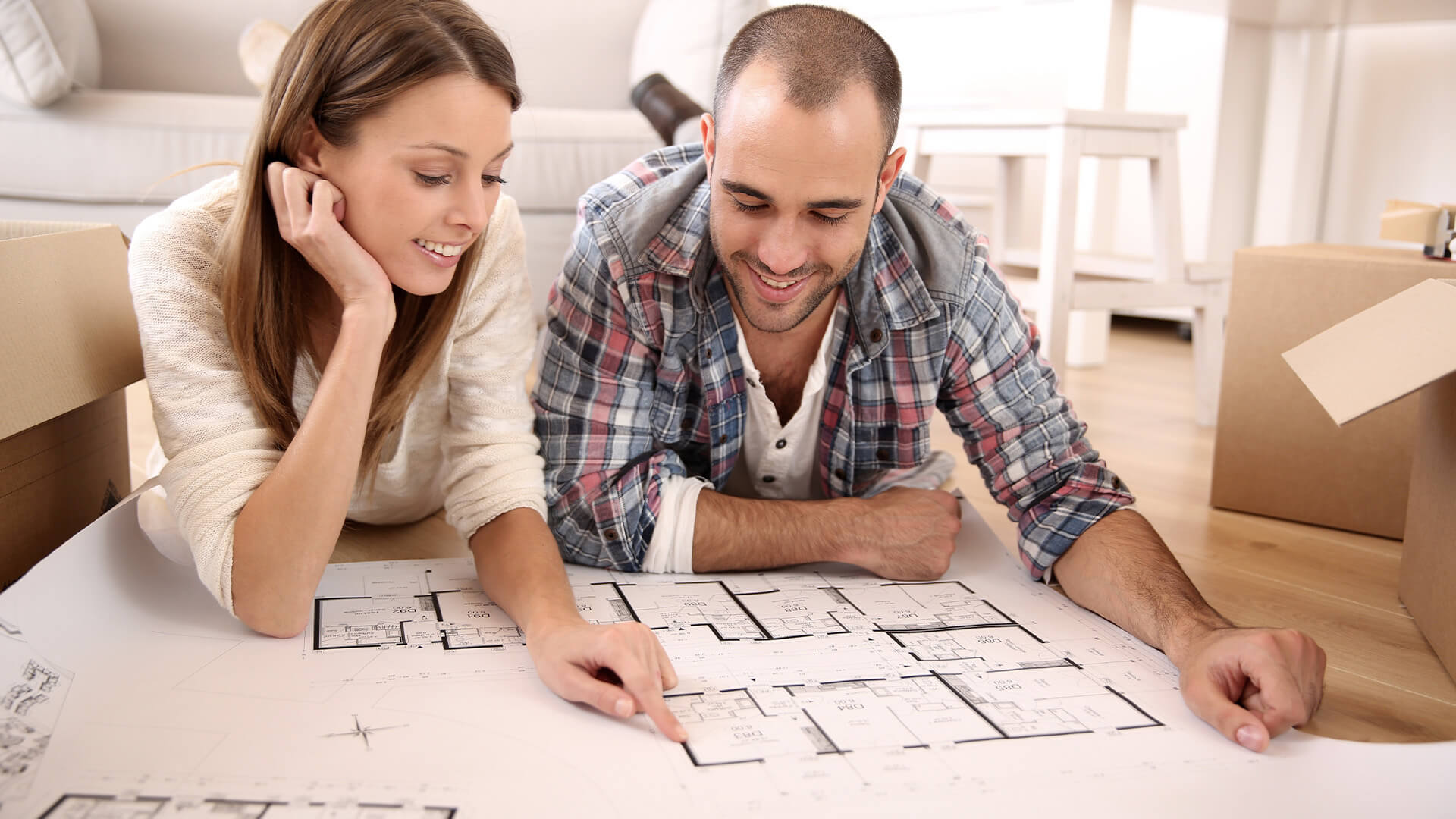 Couple lookng at floor plans and making decisions